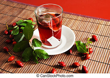 dog rose tea - Cup of tea and ripe hip roses dog rose fruit...