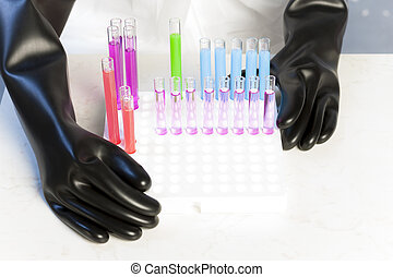 detail of woman with test tubes in laboratory