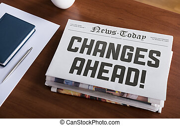 Changes ahead - Newspaper with hot topic Changes Ahead lying...