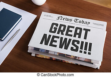 """Great news - Newspaper with hot topic """"Great news"""" lying on..."""