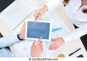 Analyzing financial chart - Businessman and businesswoman...