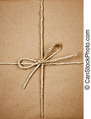 Package in brown paper tied with string - Gift package...