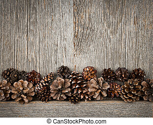 Wood background with pine cones - Rustic natural wooden...