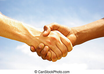hands - Two young businessmen shaking hands