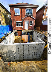 Building addition to home - Building addition to residential...