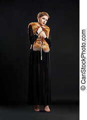 Fashion Model in Black dress and Fox Fur Mantle - Glamour Style
