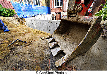 Building addition to home - Backhoe scoop at residential...