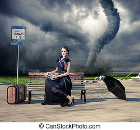 woman and tornado - woman,waiting a bus and tornado photo...