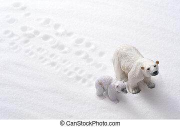 Polar bear family dolls on snow background