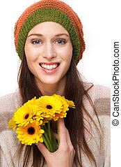 Smiling Young Woman with Yellow Flowers