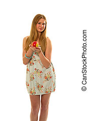 A young girl with an apple in his hand