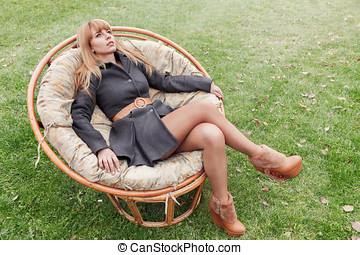 Young woman outdoor portrait - Young woman sitting in chair...