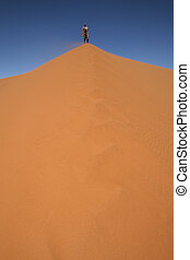 Man on top of the dune