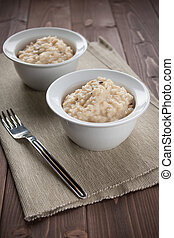 Risotto with black truffle - bowl of risotto with black...