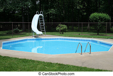 Backyard Pool - Swimming pool in the back yard with sliding...