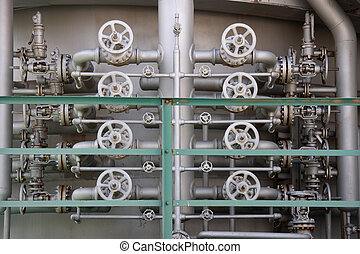 Valves - Detail of an industrial plant showing eight valves