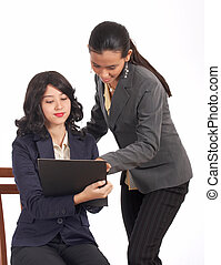 female escritoire showing the report  to her manager