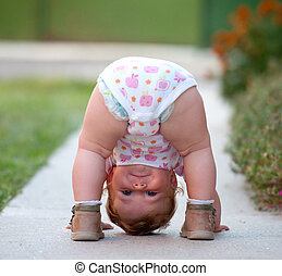 Baby is just playing on the street - One-year baby girl...