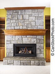 Natural Gas Fireplace and Crafted Stone and Wood Mantels