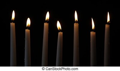 Seven Candles Loop - Loop features seven tall white lighted...