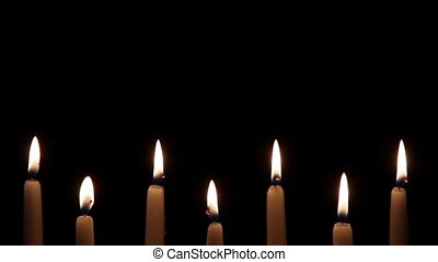 Seven Candles Lower Third Loop - Seven white candles with...