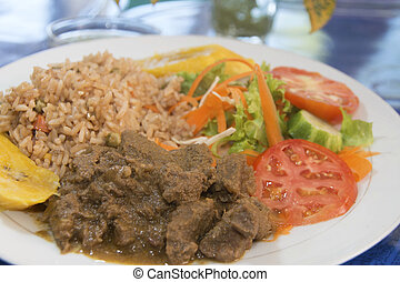 beef stew with rice salad Bequia St. Vincent and the...