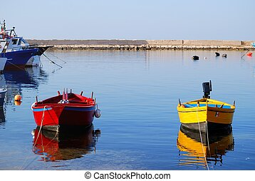 Small boats moored in the harbor of Savelletri in the...