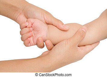 massagebaby,Mother hand massaging forearm of her baby -...
