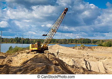 sand pit in sunny day - machinery at sand pit in sunny day