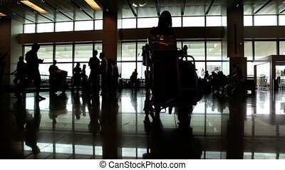 In airport - Silhouette of people waiting in airport