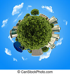 concept miniature globe with building and forest