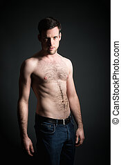 Young man in blue jeans - Handsome young muscular man in...