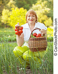 Happy woman with vegetables - Happy mature woman with...