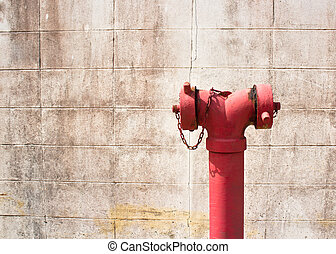Red fire hydrant - Old red metallic fire hydrant on street