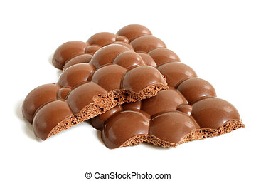 Porous chocolate pieces on a white background