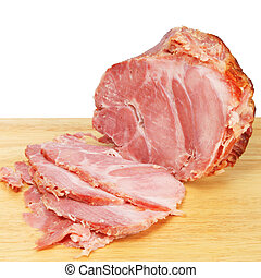 Carved ham joint on a wooden board