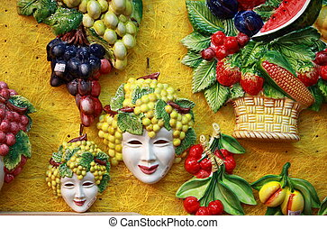 Bacchus masks and fruit decorations