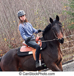 Standard Breed horse and rider - a young beautiful teenage...