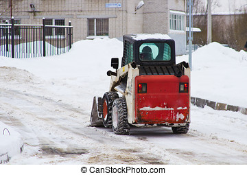 An automated snow removal  - snow removal with a tractor