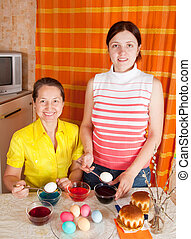 Two women coloring Easter Eggs