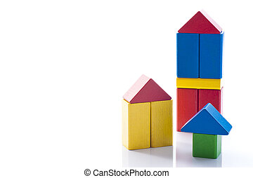 building block house - Wooden house made of colorful...