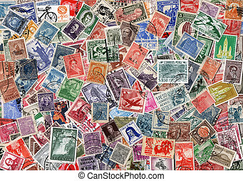 background of old used Latin American postage stamps -...