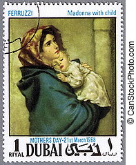Madonna with child - DUBAI - CIRCA 1968: A stamp printed in...
