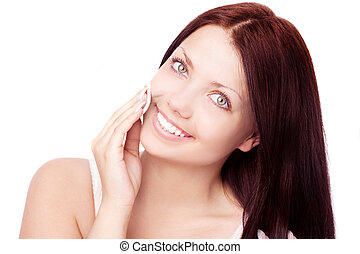 woman using cotton pads - beautiful young brunette woman...