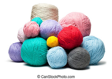 colorful balls of woolen threads isolated over white