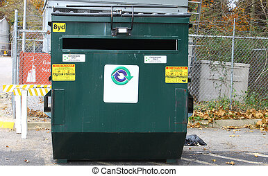 A large green cardboard only recycling dumpster