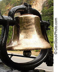 Train Bell In The Rain - Brass train bell with water...