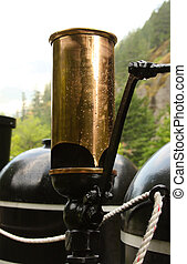 Steam Train Whistle - Brass steam train whistle in the rain