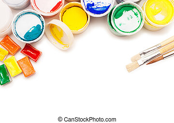 gouache paint, watercolours and brushes isolated over white...