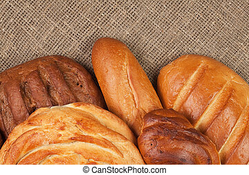 variety of fresh bread over sackcloth background
